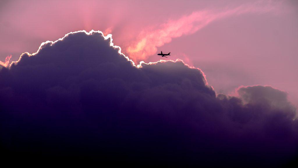Pink Sunset & Airplane | Heidi McBain, Women's Counselor & Online Therapist in Flower Mound, Texas