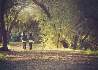 Girls Walking Through Trees | Heidi McBain, Women's Counselor & Online Therapist in Flower Mound, Texas
