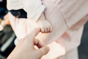 Baby's hand grasping an adult's finger | | Heidi McBain, Women's Counselor & Online Therapist in Flower Mound, Texas